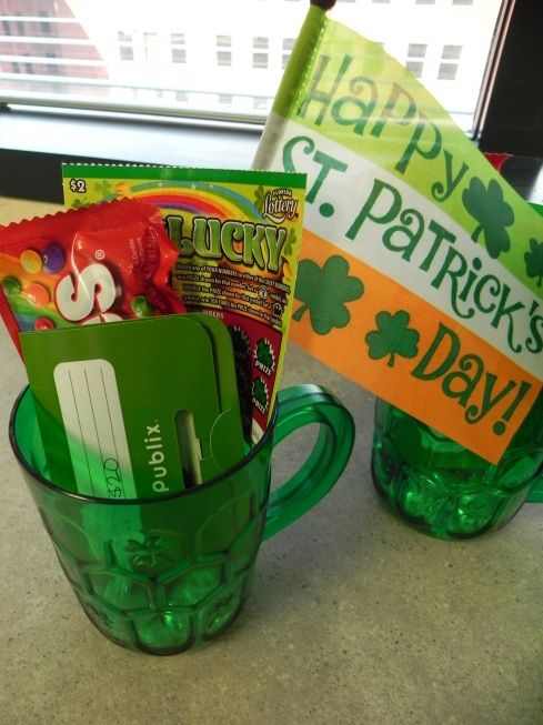 St Patrick's Day Prizes {Kisses, Skittles, St Patrick's Day themed scratch off ticket, flag, and green gift card}
